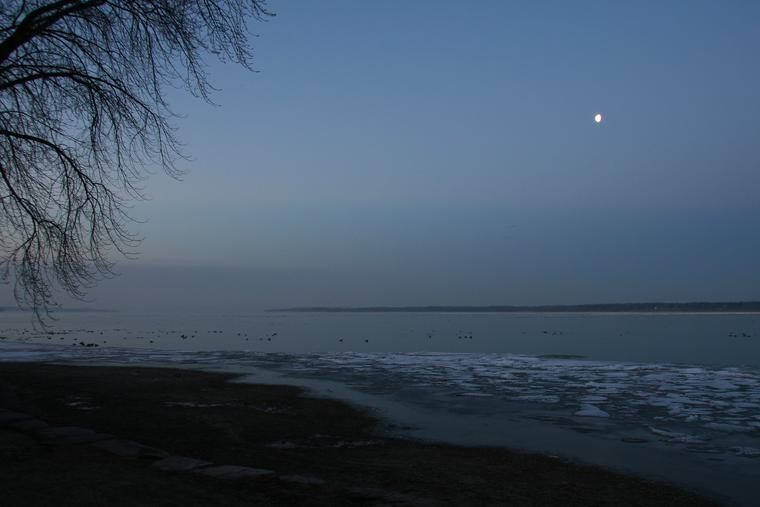 Morning moon on Cayuga Lake photo